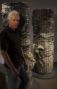 Picture of artists Graham Hay with The Kiss sculpture made from thousands of ceramic smart phones.  Photographer is Kevin Gordon.