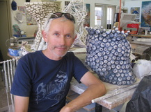 Picture of Artist Graham Hay in Robertson Park Artists Studio with paper clay sculpture he is  decorating. Photo:  Graham Hay